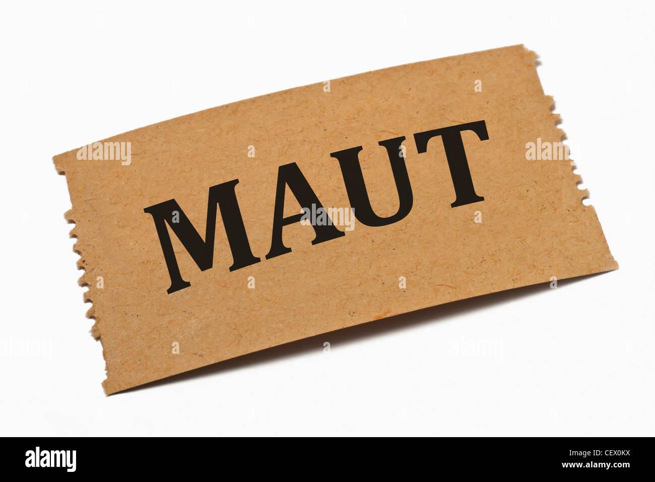 Detailansicht einer Karte aus Papier mit der Aufschrift Maut | Detail photo of a paper card with the inscription - Stock Image