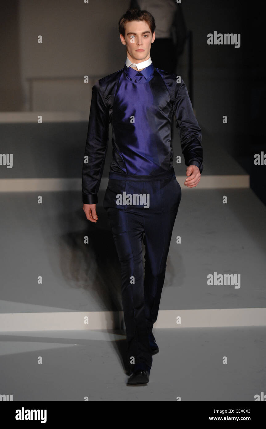 Prada Milan Ready to Wear Autumn Winter  Shiny two tone dark blue taffeta shirt and slim trousers, with detached - Stock Image