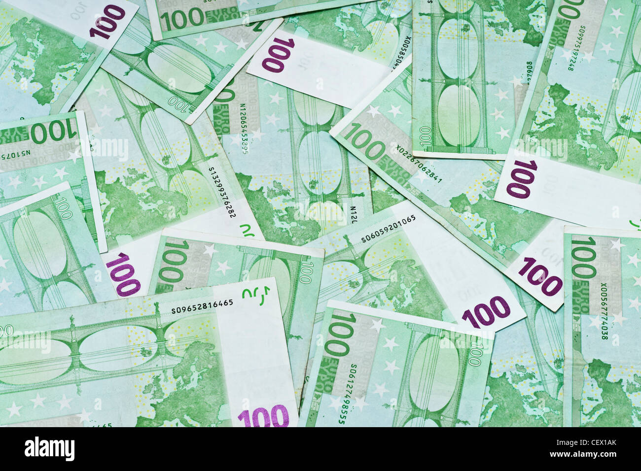 Many 100 Euro Banknotes are next to each other. On January 01st 2002 the Euro was introduced as cash. - Stock Image