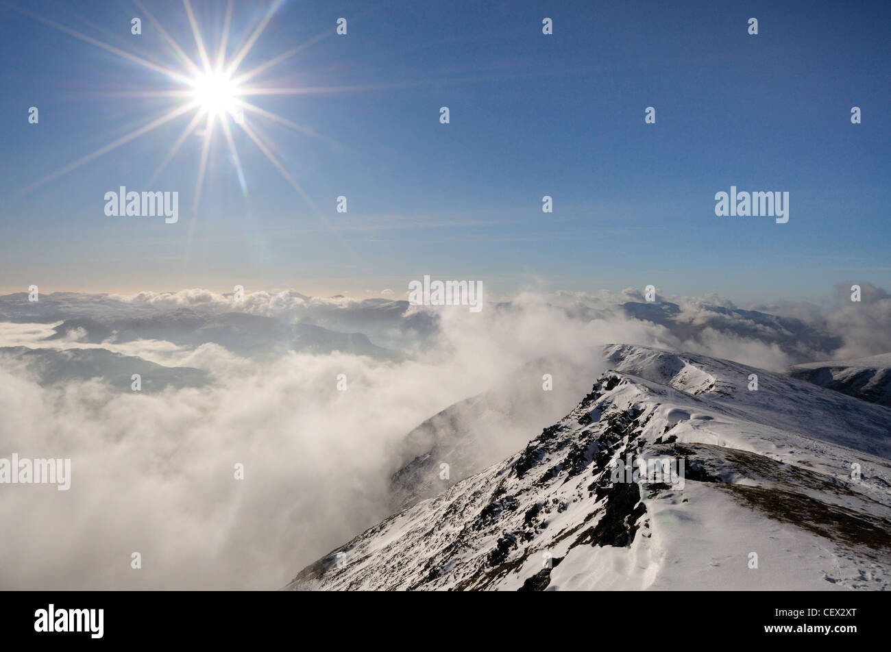 Starburst above Blencathra summit ridge above a temperature inversion in the English Lake District - Stock Image