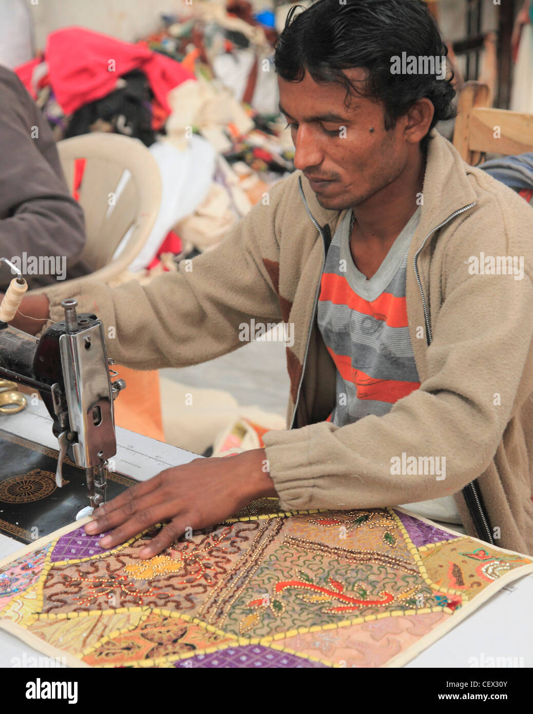 India, Rajasthan, Jodhpur, man sewing, workshop, - Stock Image