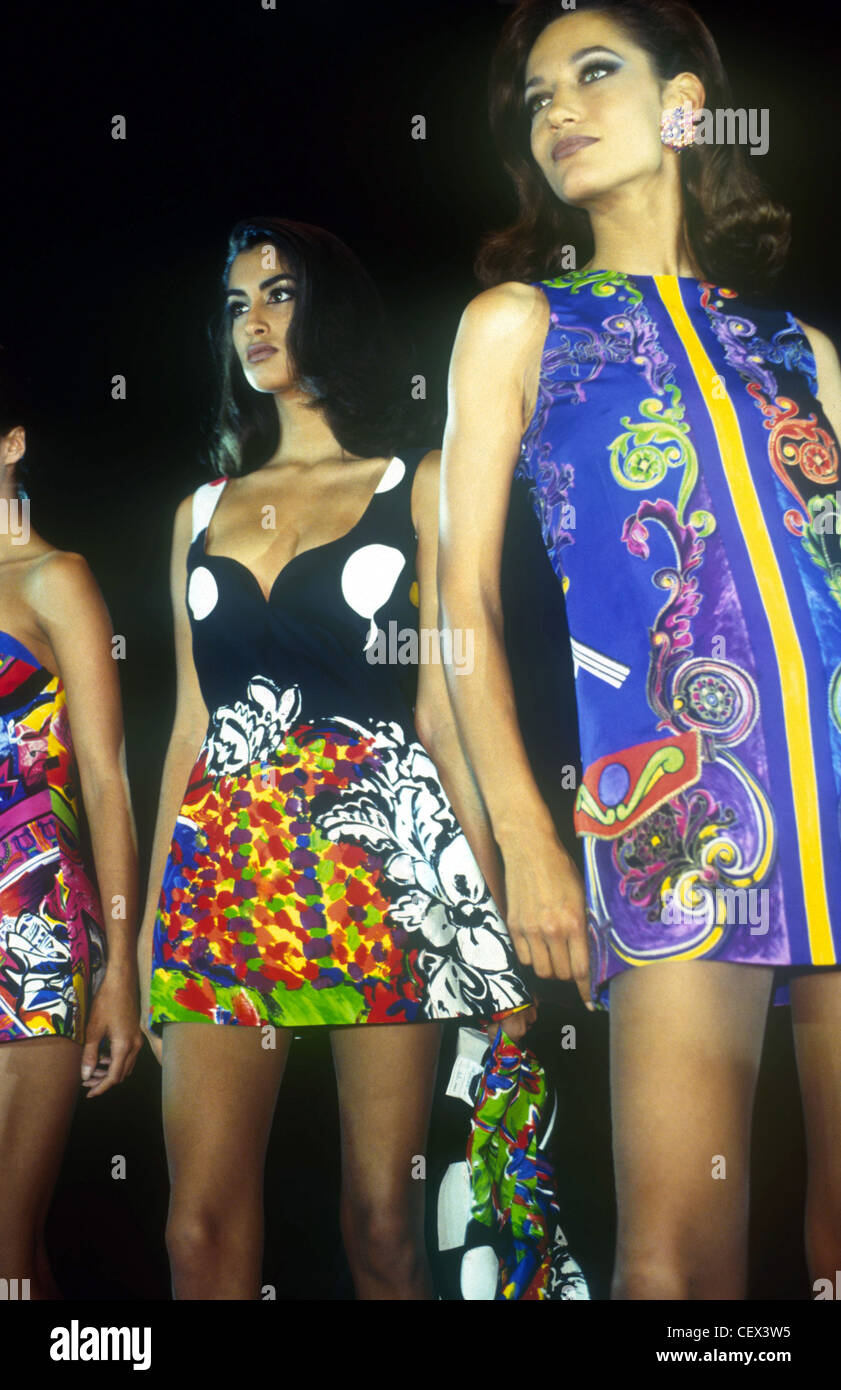 196e50a3827 s Fashion Versace Three models long brunette hair wearing colourful printed  minidresses