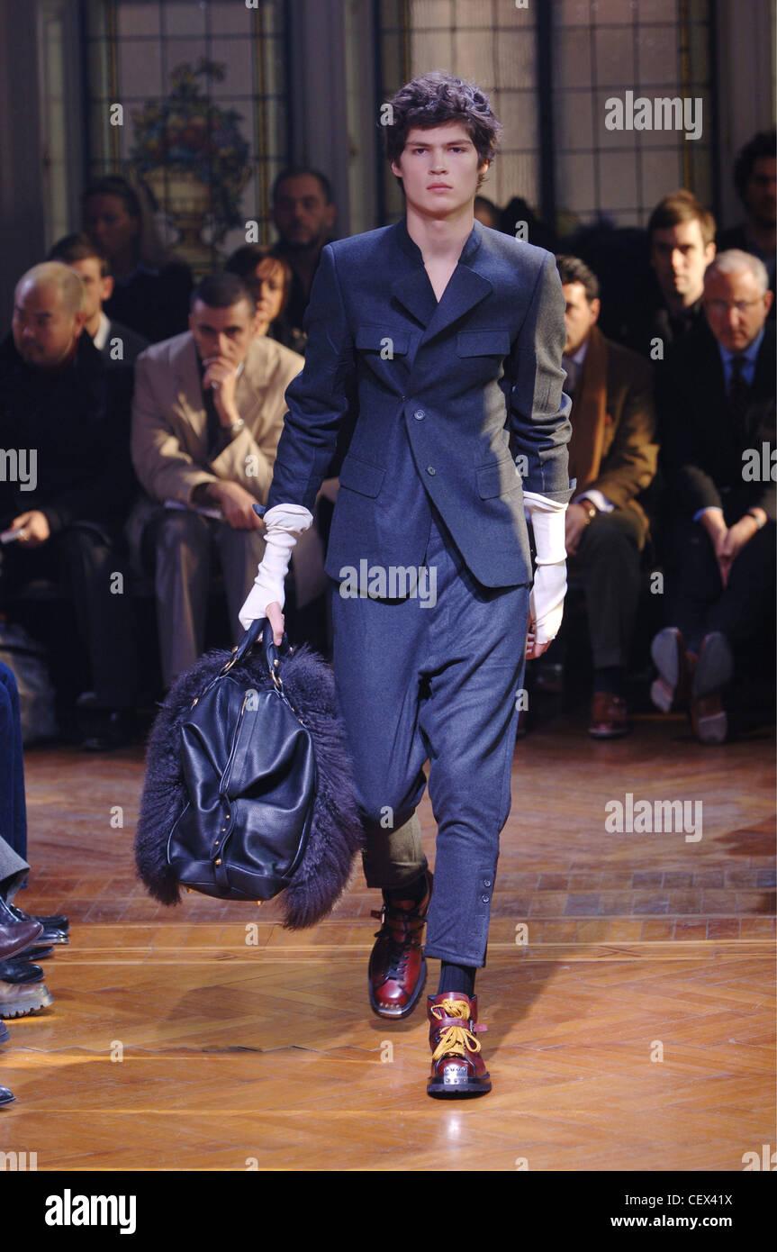 45a0c367913 Miu Miu Menswear Milan A W Brunette male wearing a grey suit cropped  trousers