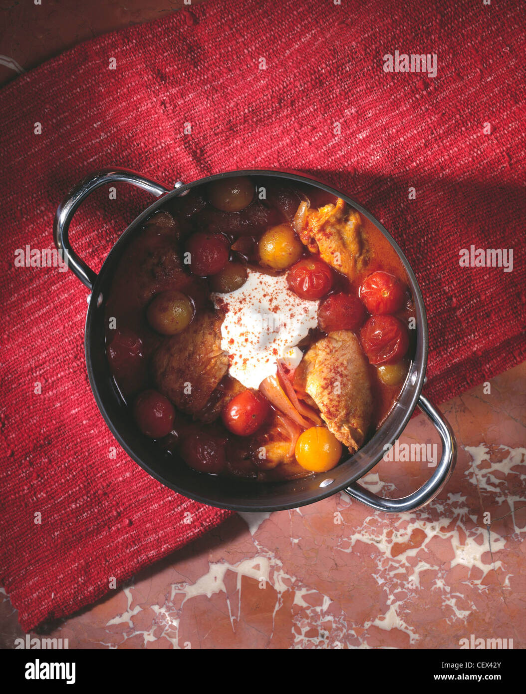 Chicken Paprikash Richly red and exquisitely sweet, this chicken casserole from Hungary is quick to prepare and - Stock Image