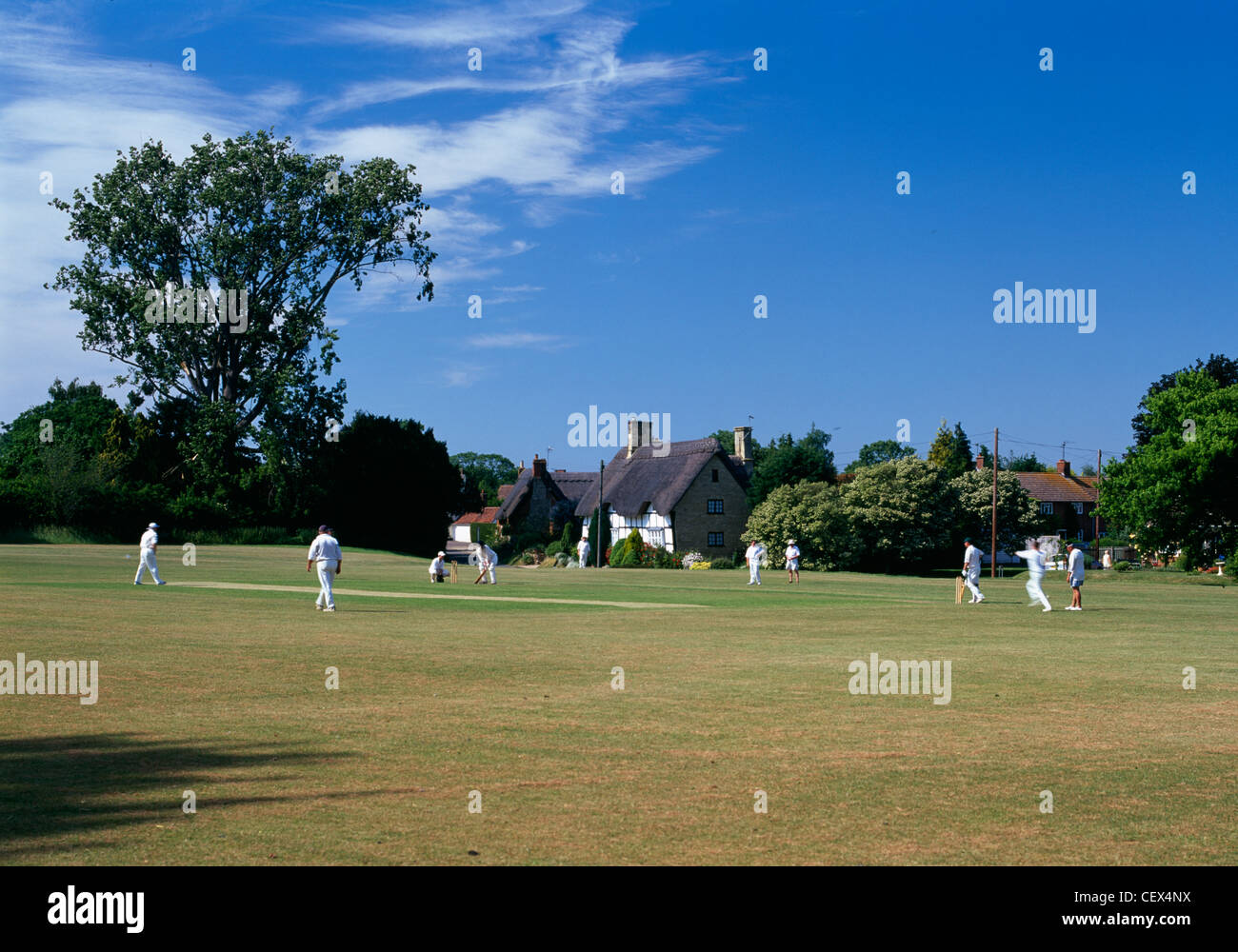 A Sunday afternoon cricket match in the village of Elmley Castle. Stock Photo