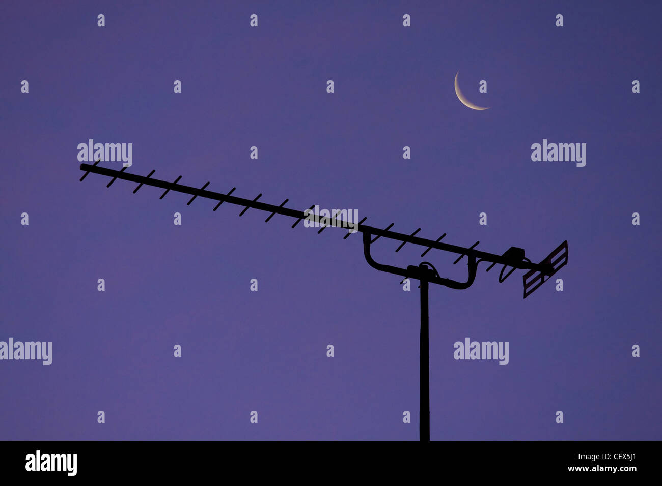 Detail of a TV aerial and a crescent moon. - Stock Image