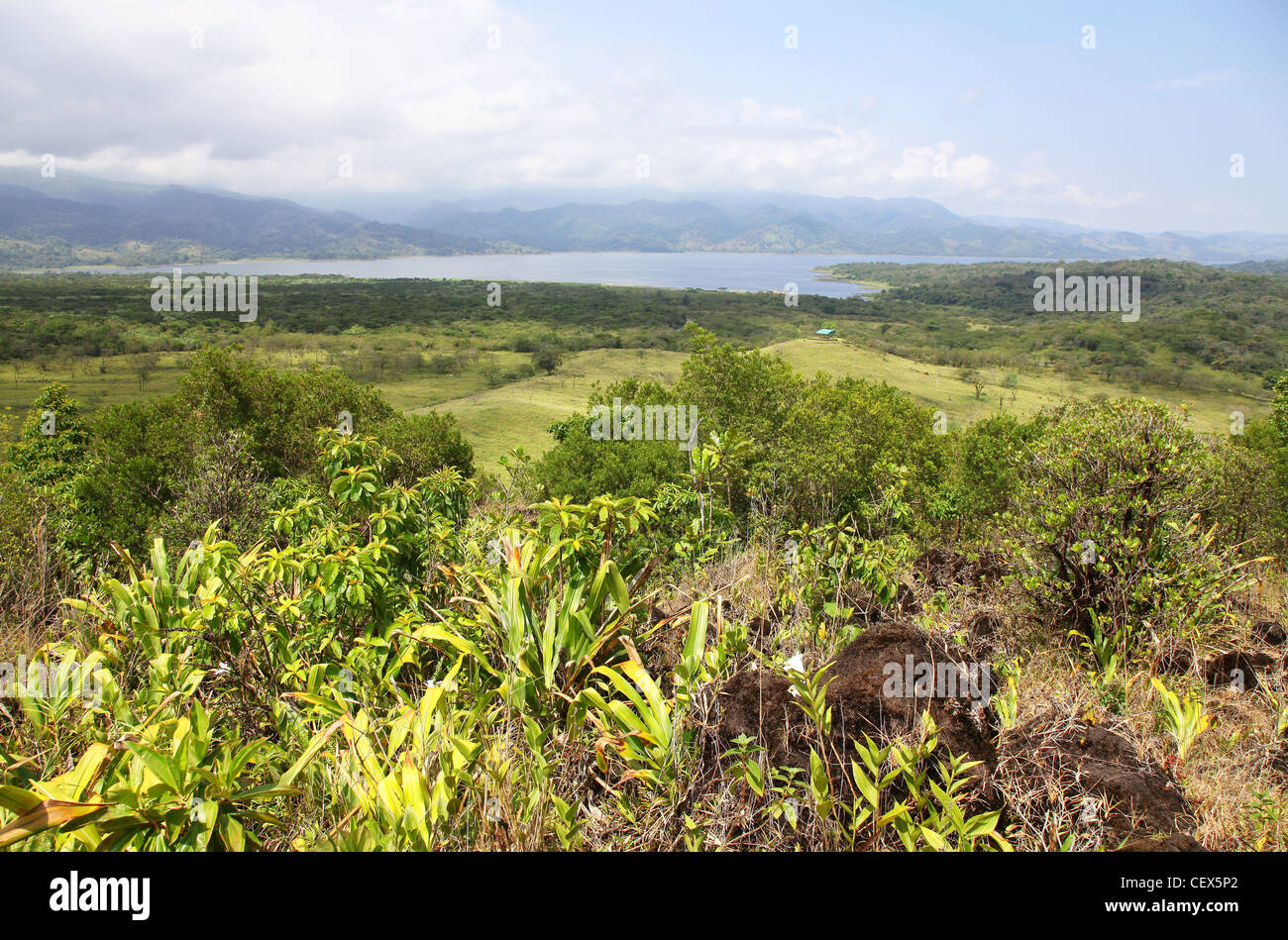 View from Arenal Volcano, or Volcán Arenal, of lake Arenal near La Fortuna, Costa Rica, Central America - Stock Image