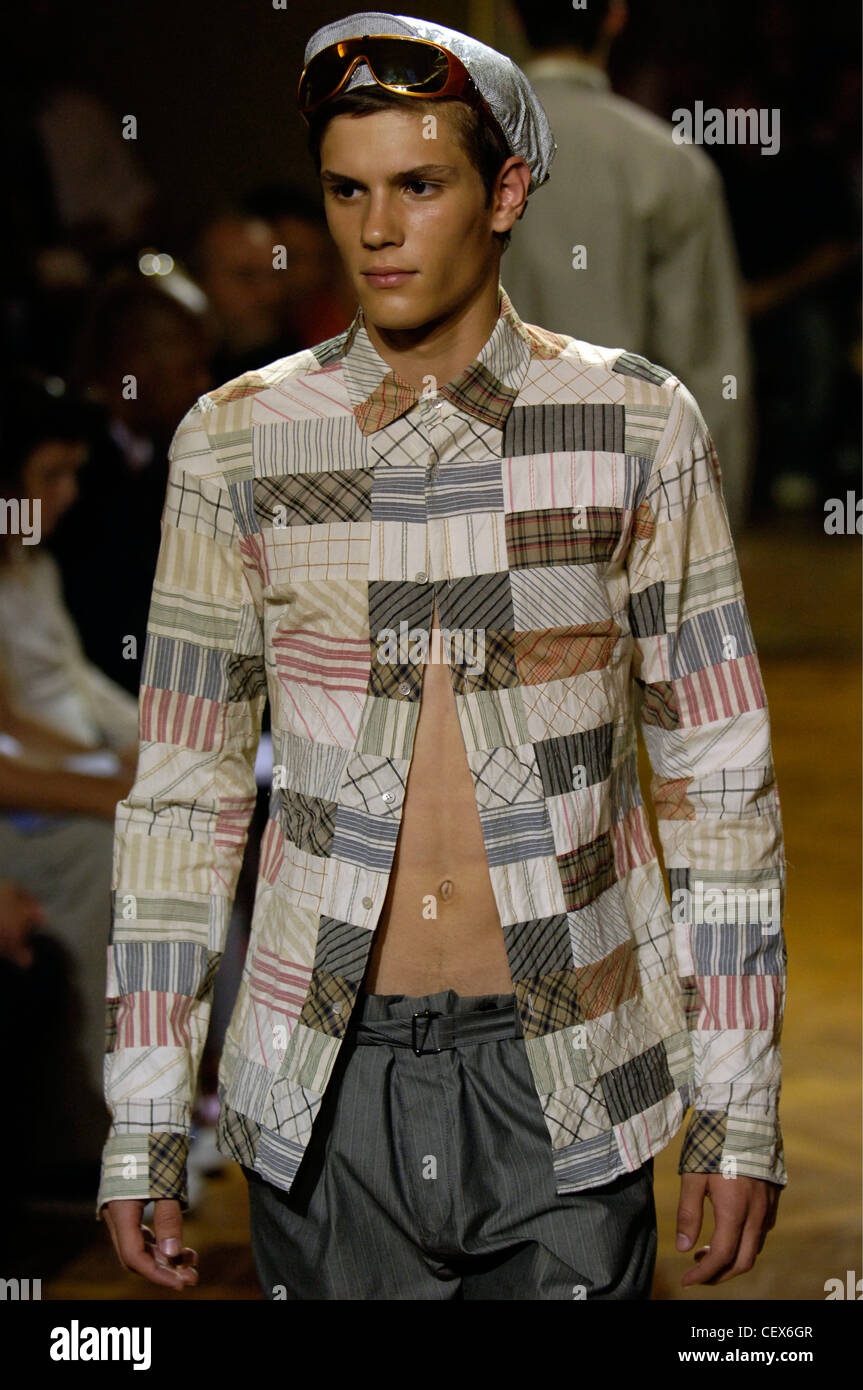 804476ea16e Miu Miu Milan Ready to Wear Menswear Spring Summer Brunette male model  wearing a patchwork shirt buttoned at the top only and