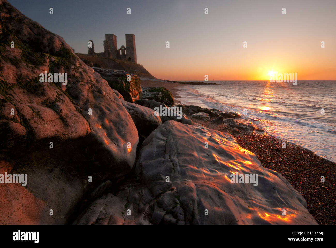 The Reculver Towers at sunset on the north coast of kent Stock Photo