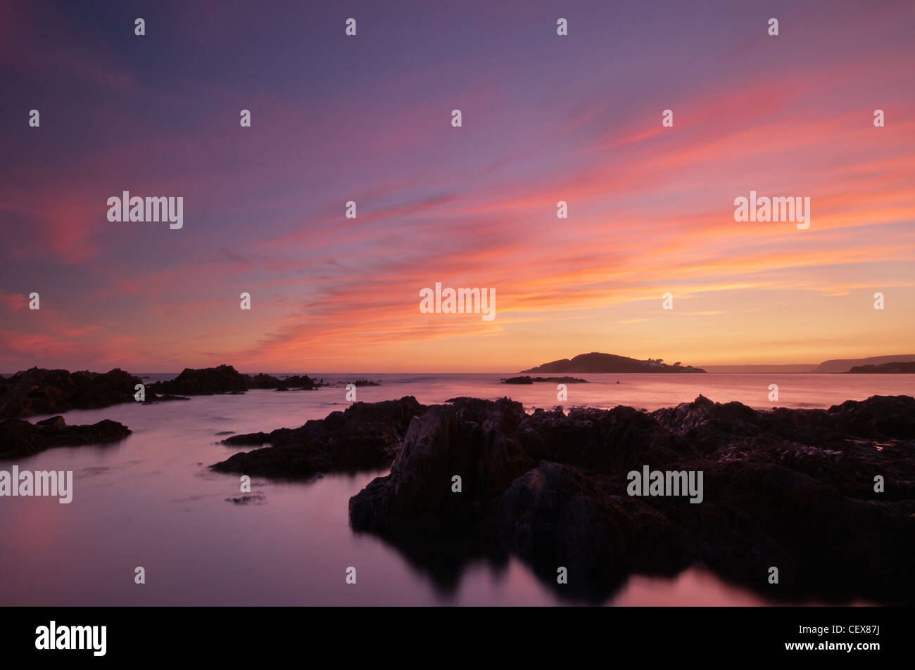View from Bantham Beach to Burgh Island at sunset, Devon, August 2011. - Stock Image