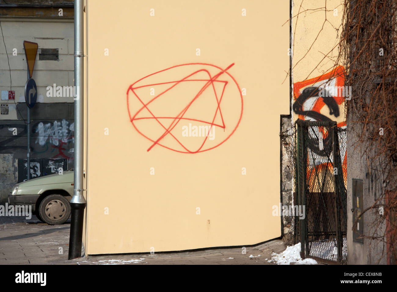 Anti-semitic graffiti on a wall in the Jewish Quarter of Kazimierz in the city of Krakow in Poland. - Stock Image