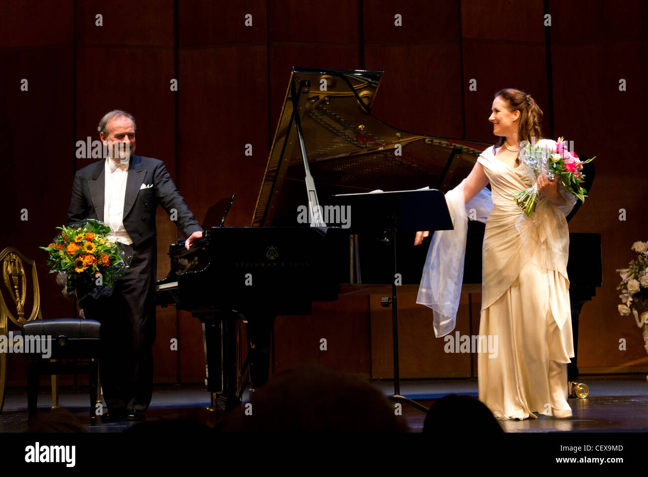 curtain call of opera singer Diana Damrau and pianist Helmut Deutsch, Deutsche Oper, Berling, Germany - Stock Image