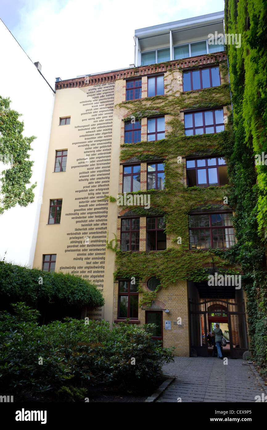 Sophie-Gips-Höfe, restored Mitte quarter of Berlin, with text on wall, Germany - Stock Image