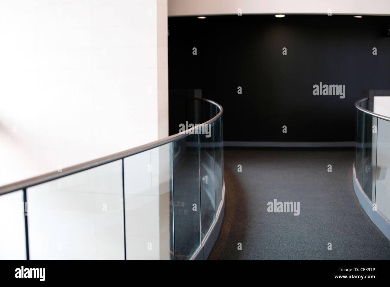 walkway with metal rail and glass panels - Stock Image