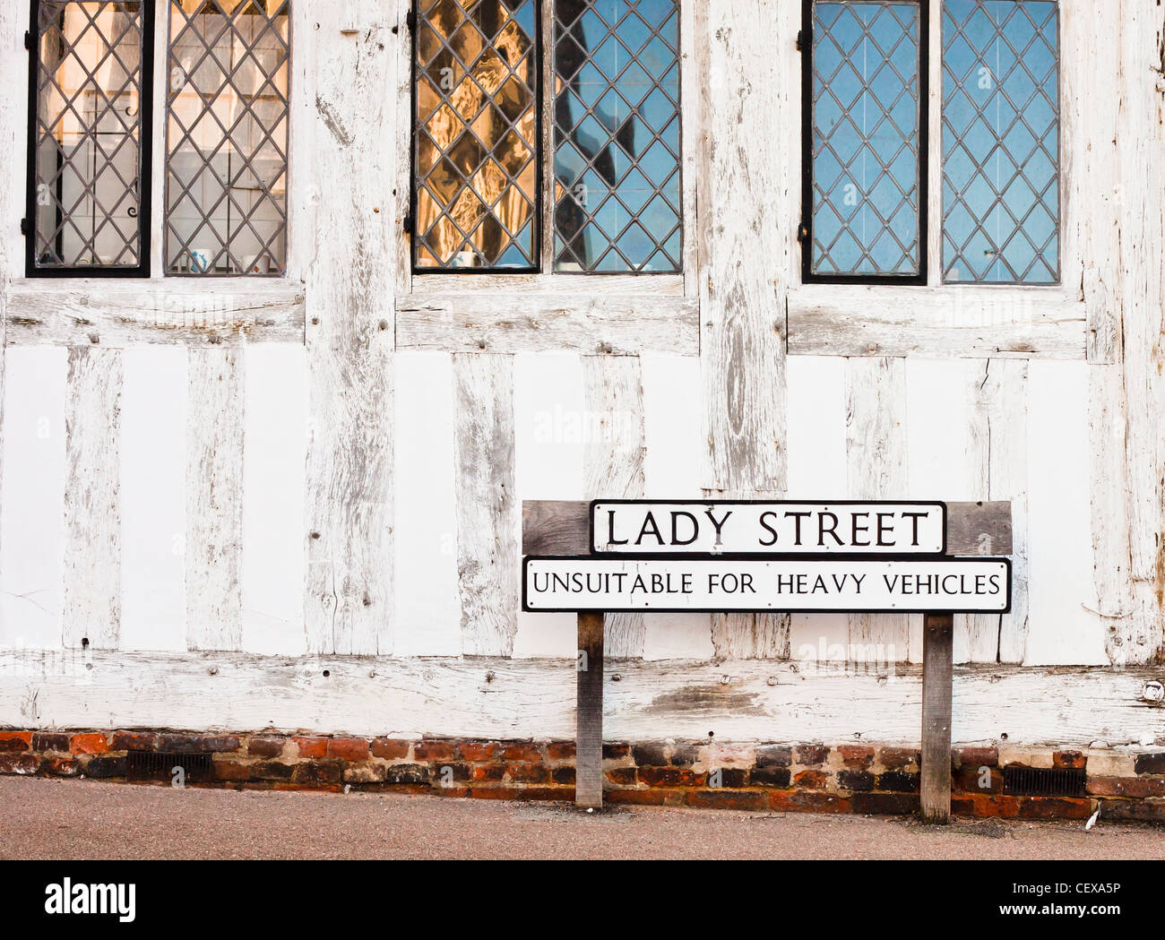 Street name and a road sign outside an old building in Lavenham, Suffolk, UK - Stock Image