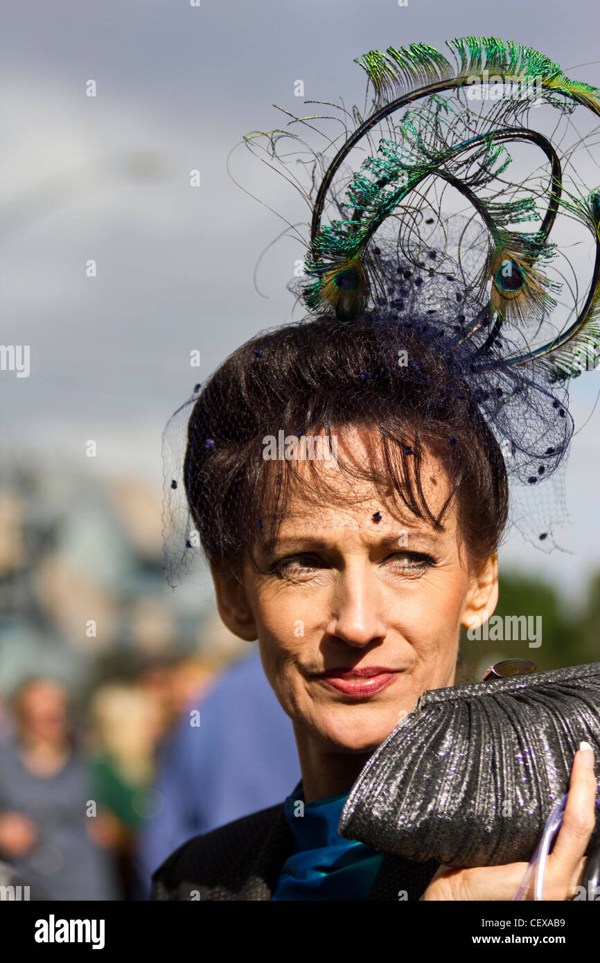 Melbourne cup patron returning from the races, Flinders Street Station, Melbourne, Australia - Stock Image