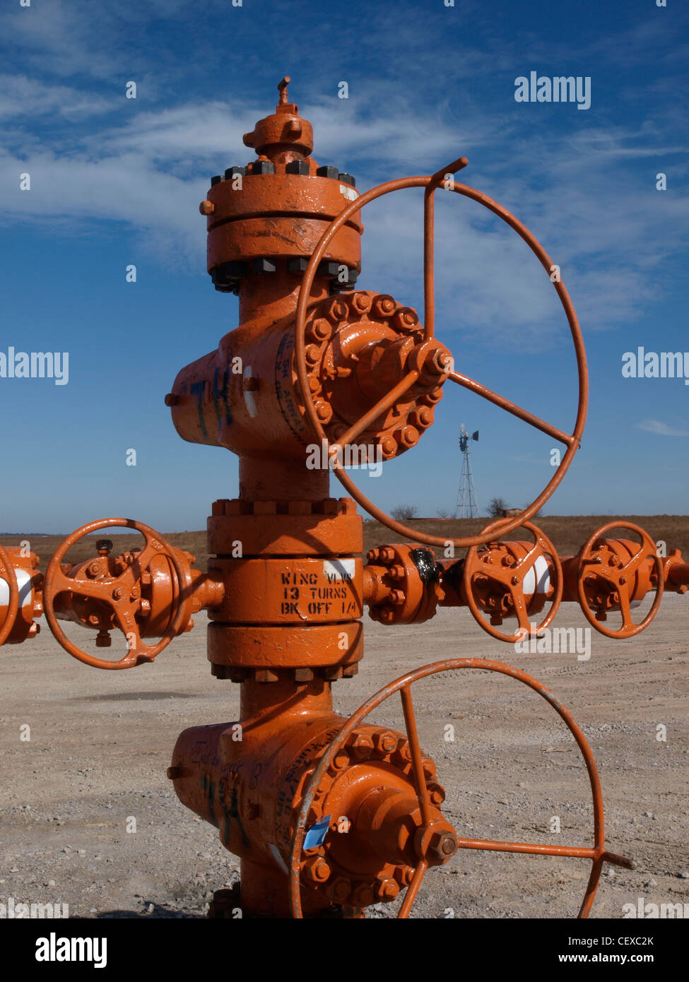 'Christmas tree' well-head, painted orange to show it is ready for  high-pressure fracturing, fracking. - Stock Image