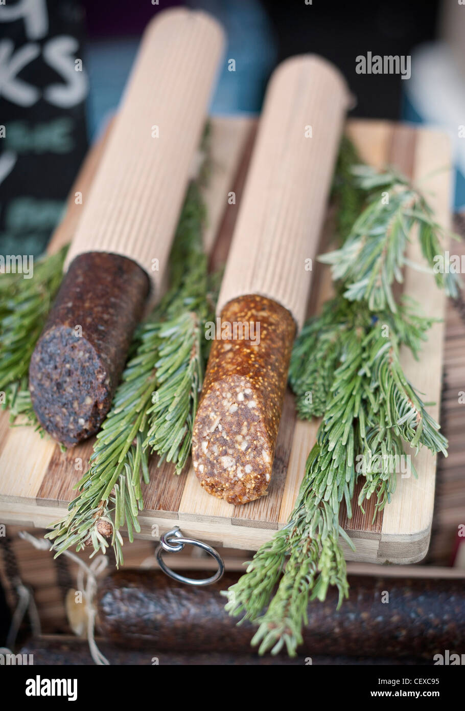 Fig and walnut salami beautifully presented on a market stall - Stock Image