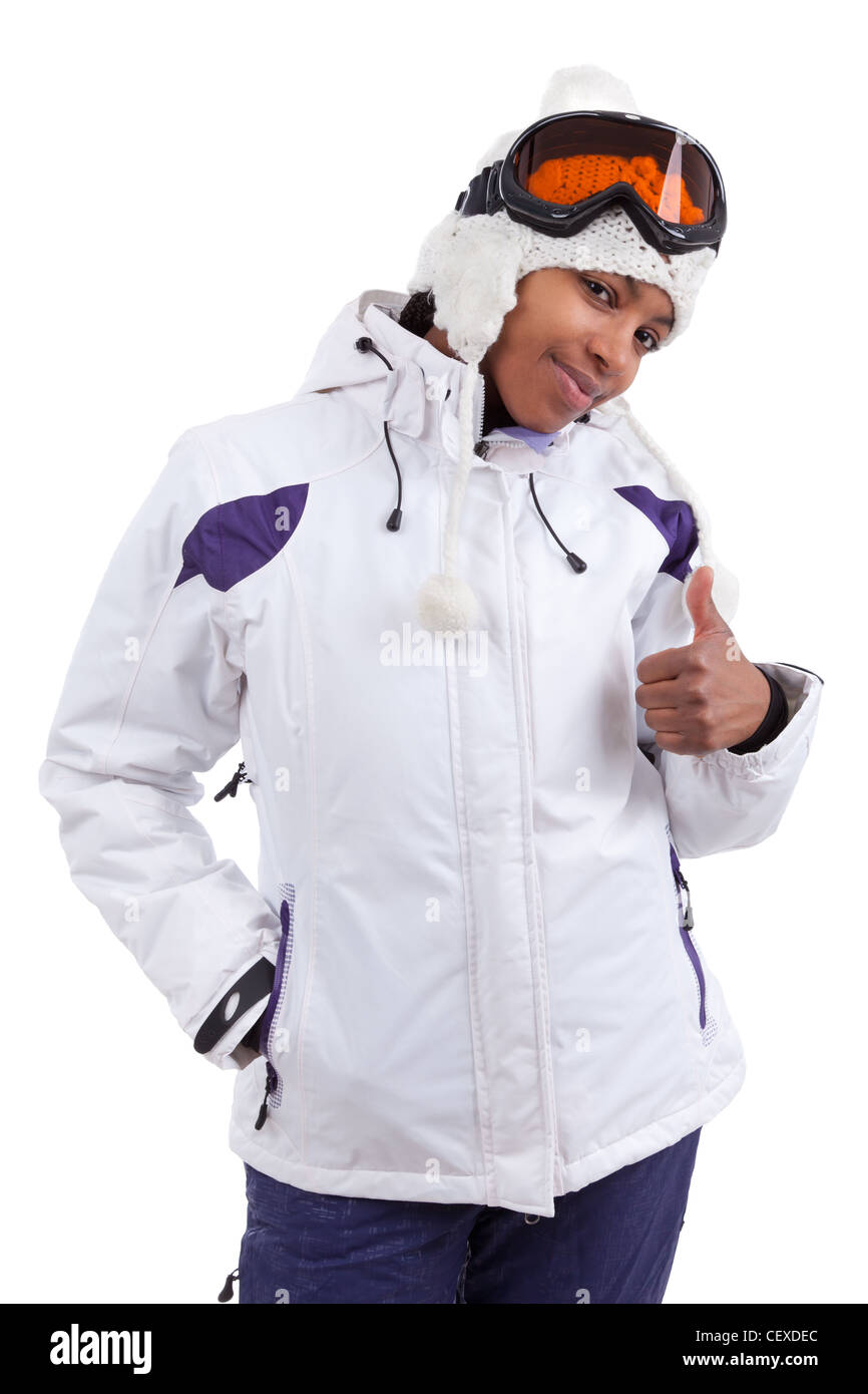 Young african woman in ski clothes making thumbs up, isolated on white background - Stock Image
