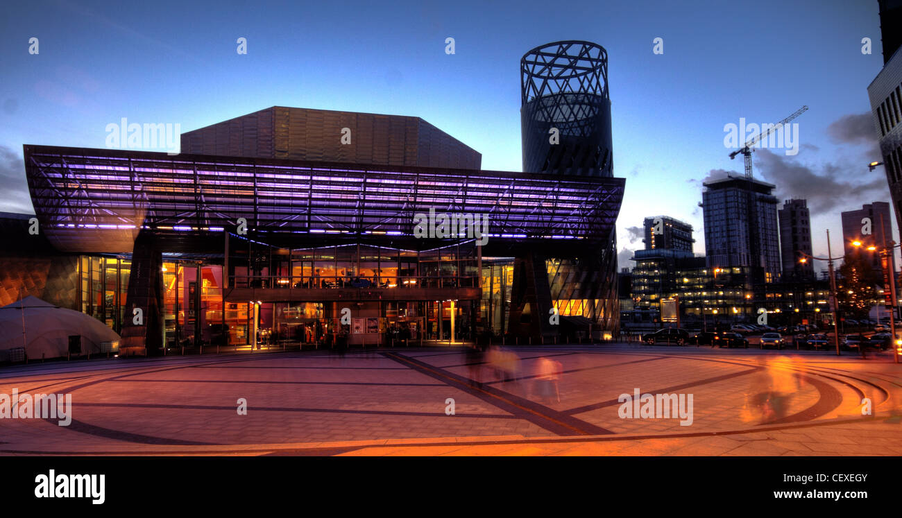 Lowry Centre Salford Quays Theatre, front view at dusk, Media City Construction at rear - Stock Image