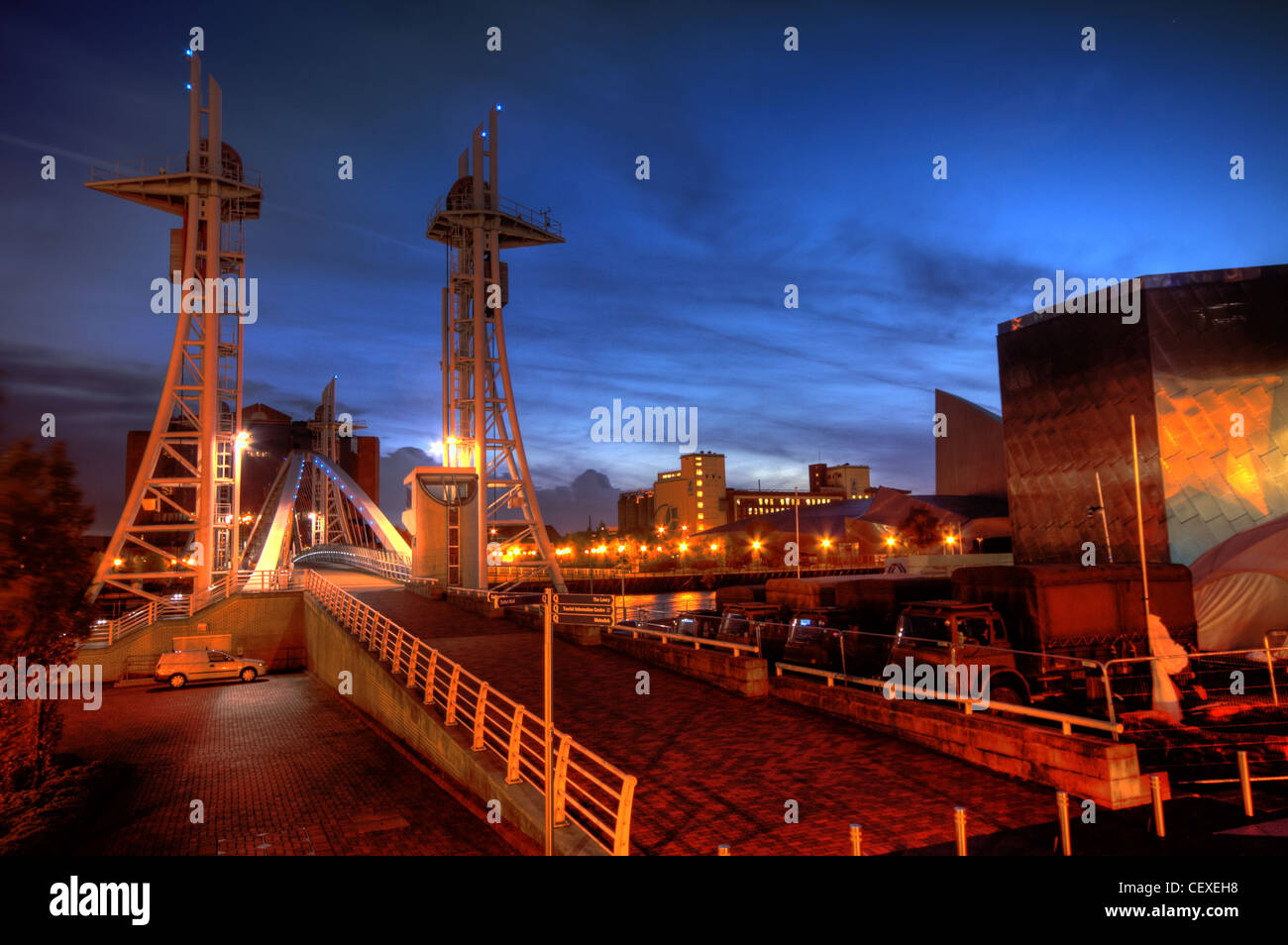 Lowry Salford Quays Millennium Lift Footbridge at dusk - Stock Image