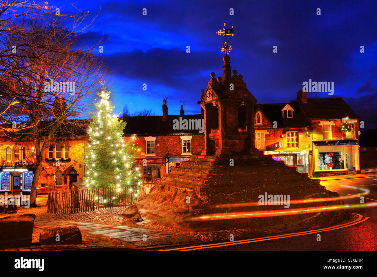 Xmas scene at the Christmas Tree at Lymm Cross, Lymm village, Cheshire, England, UK - Stock Image