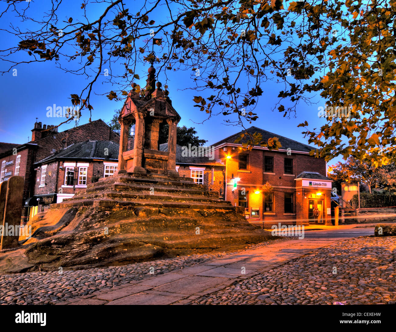Autumn scene at Lymm Cross, Lymm village, Cheshire, England, UK - Stock Image