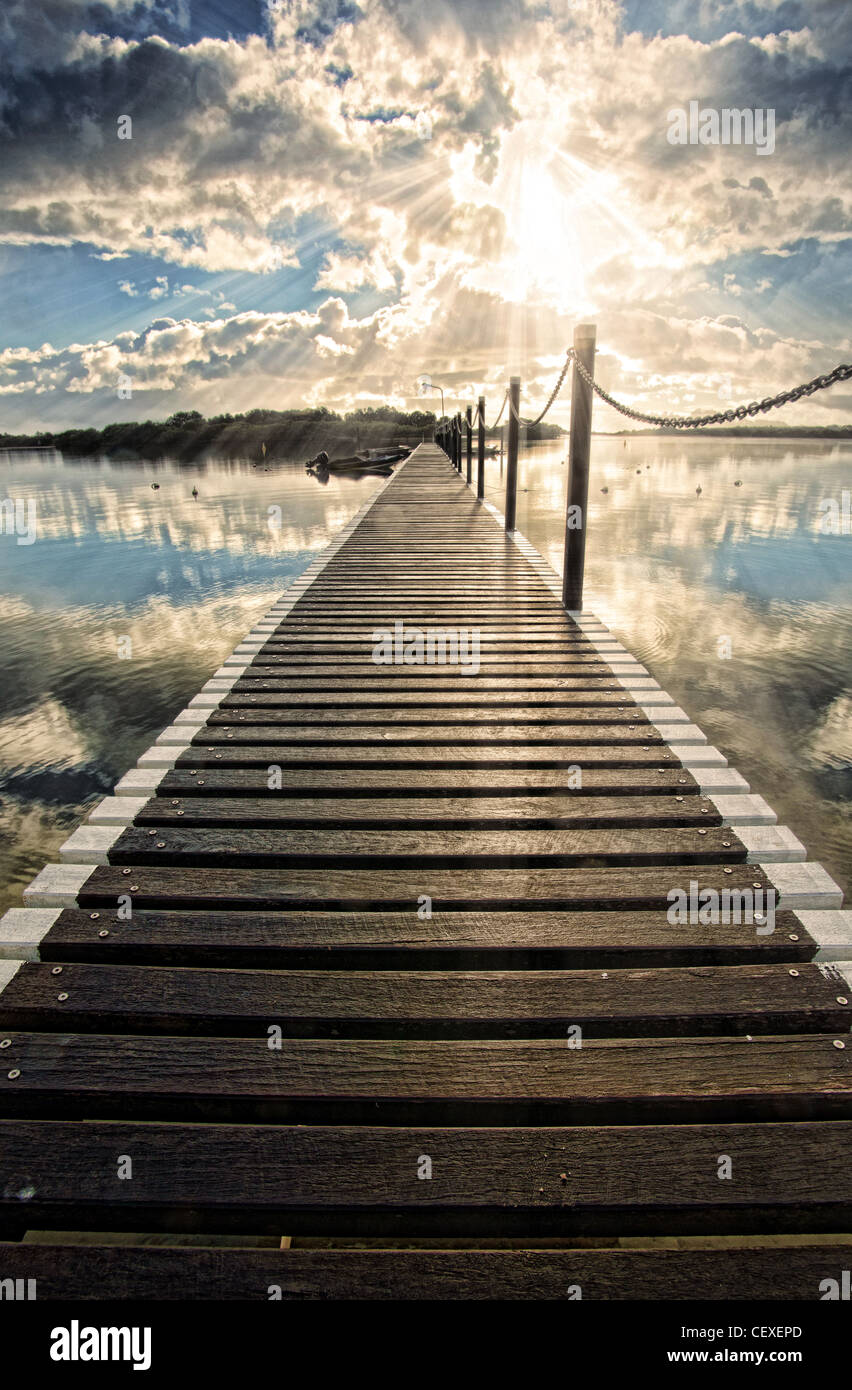 pontoon jetty stretches out into the water at yamba - Stock Image