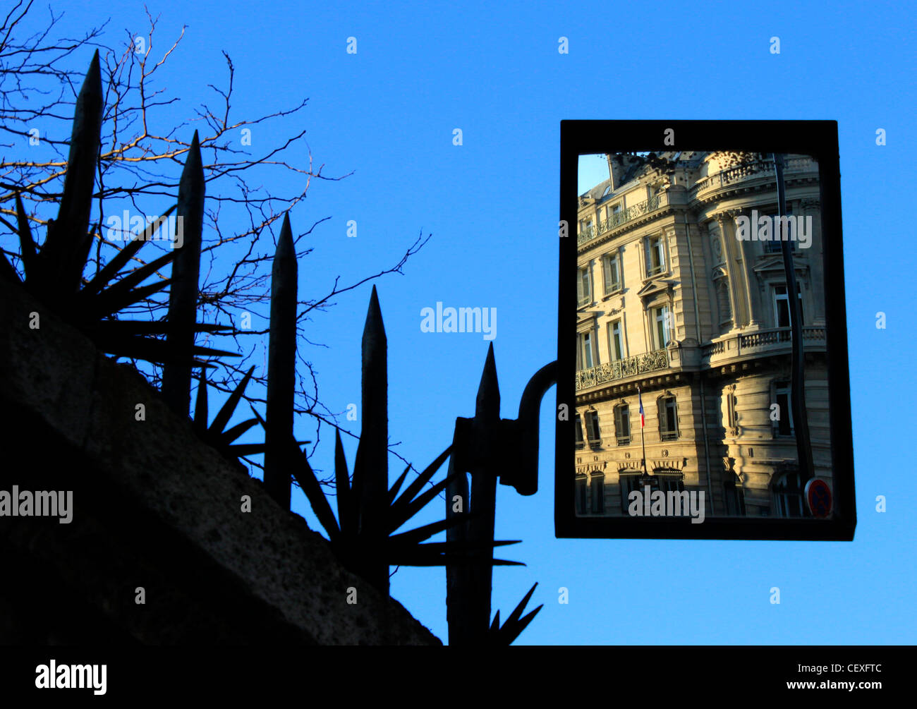 A building's facade is reflected in a mirror in a security fence in Paris, France, December 26, 2011. - Stock Image
