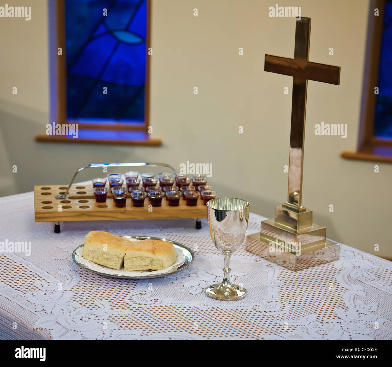 communion emblems set up on a table with a cross; sheffield, south yorkshire, england - Stock Image