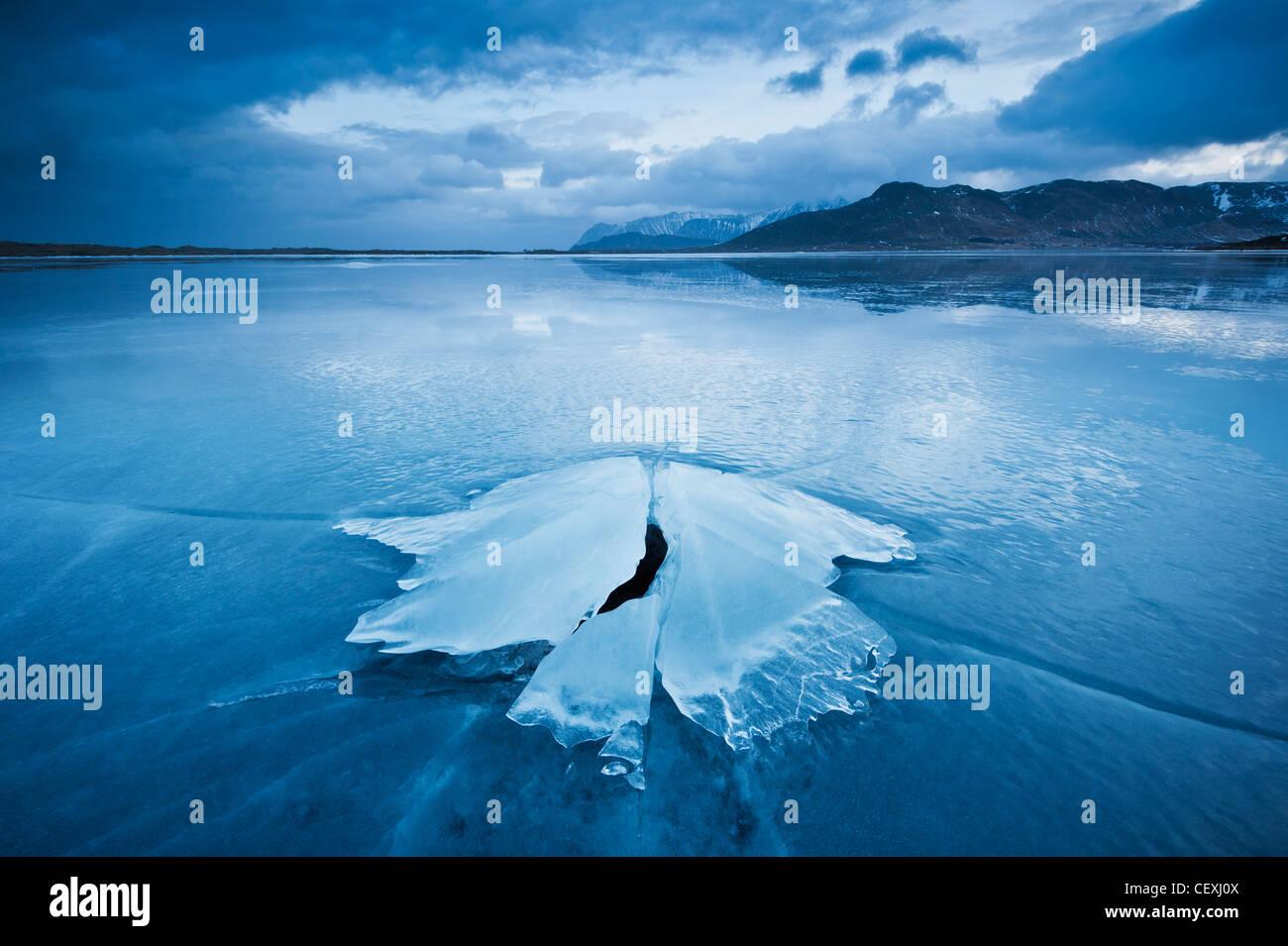 Ice formation of frozen coast of Ytterpollen, Lofoten Islands, Norway - Stock Image