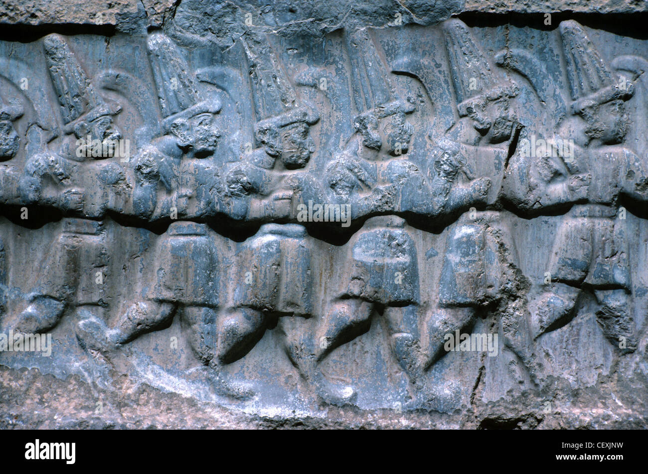 Bas-Reliefs or Rock Carvings of Procession of Hittites or Hittite Soldiers or Gods, Hattusa Bogazkale, Turkey - Stock Image