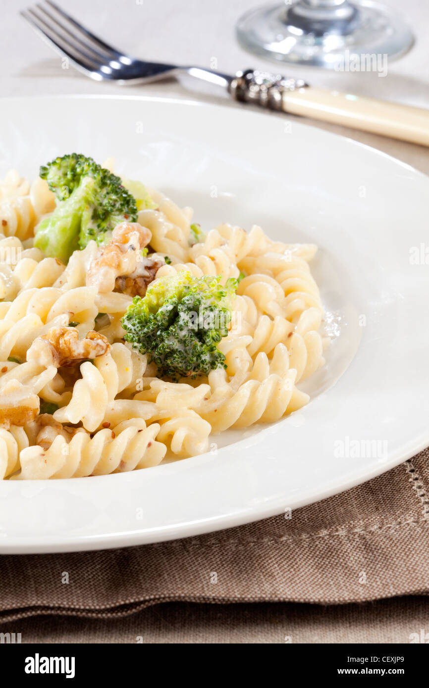 fusilli pasta with broccoli and walnut sauce - Stock Image