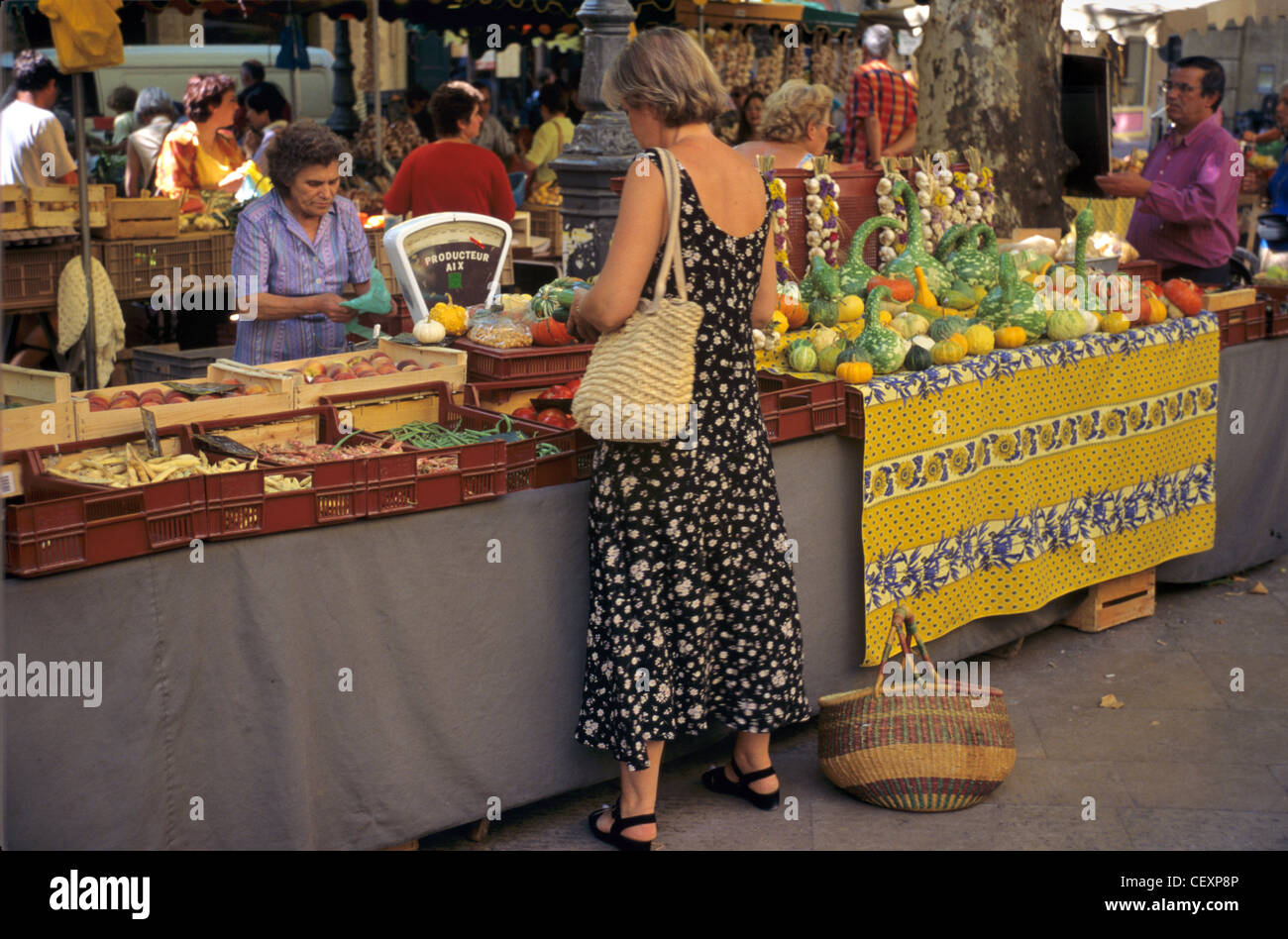 A Woman Shops at the Fruit and Vegetable Morning Market, Aix-en-Provence, France - Stock Image