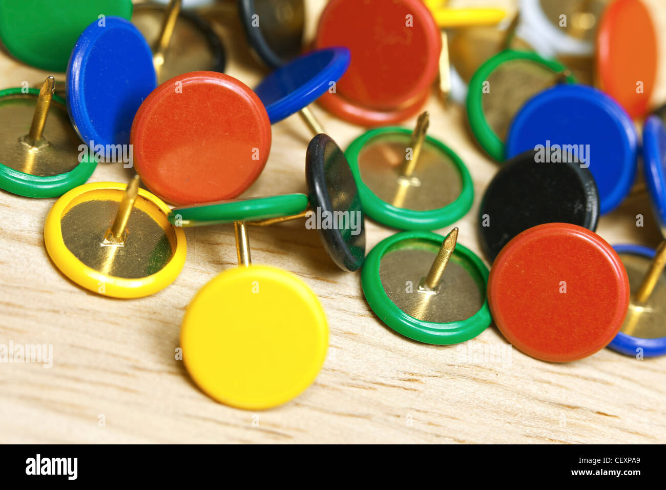 Pushpins on the table. Selective focus. - Stock Image