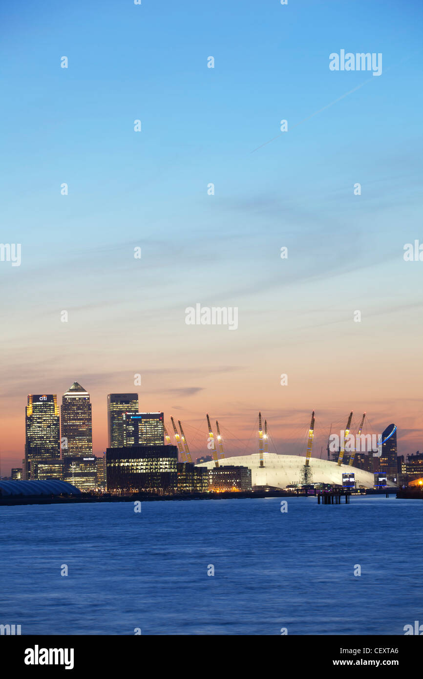 A view down th river Thames towards the City of London and the O2 Arena and Canary Wharf at sunset - Stock Image