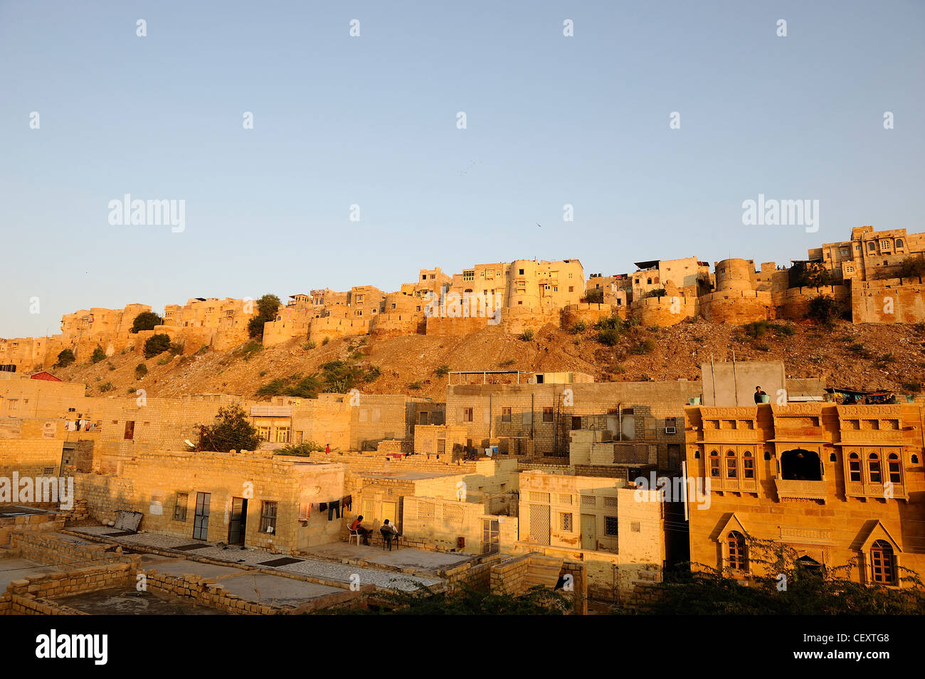 The 900 year-old sandstone fort of Jaisalmer at sunset. Jaisalmer; Rajasthan, India. - Stock Image