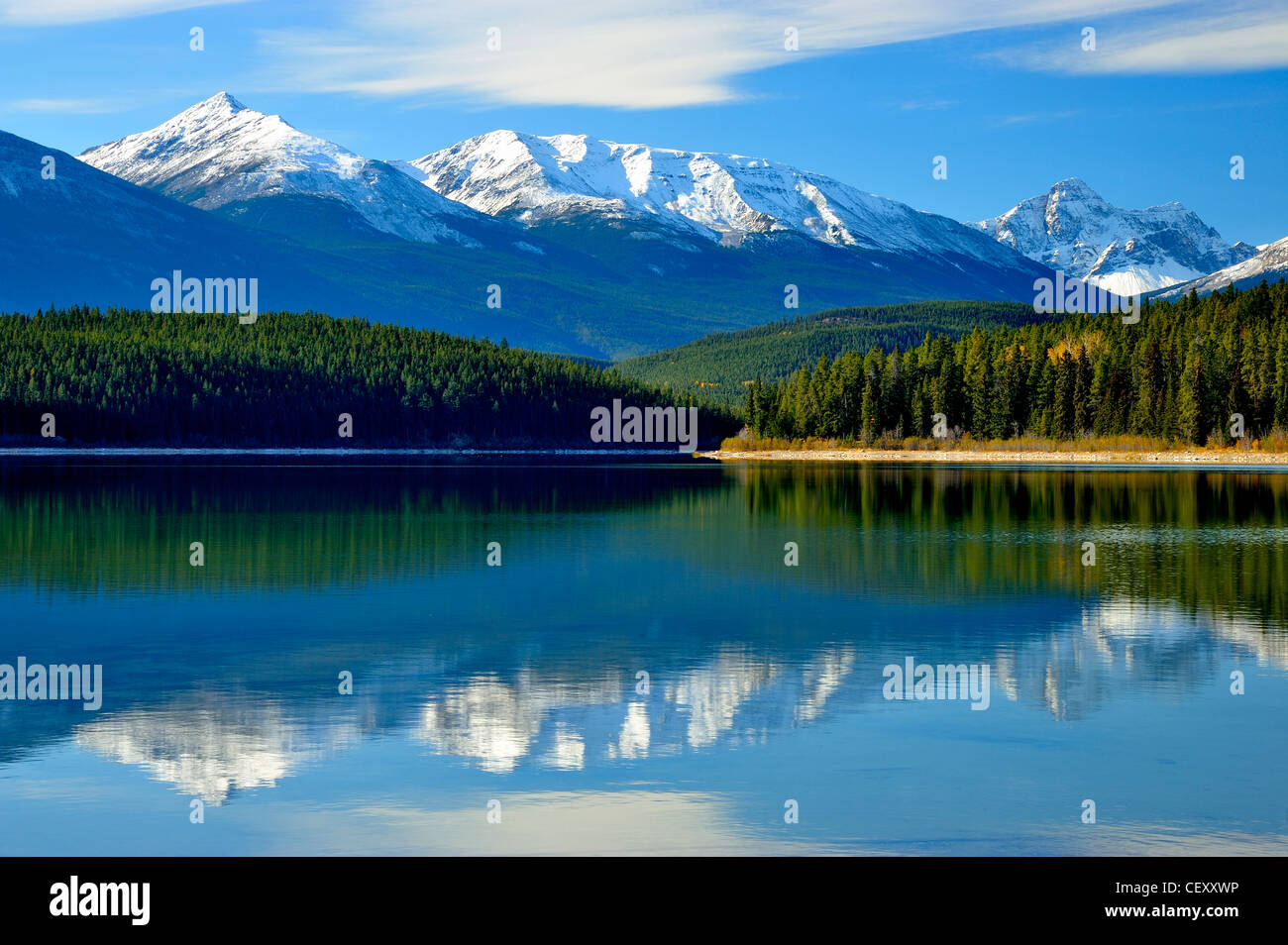 Patrica Lake with the snow-capped rocky mountains in the background. - Stock Image