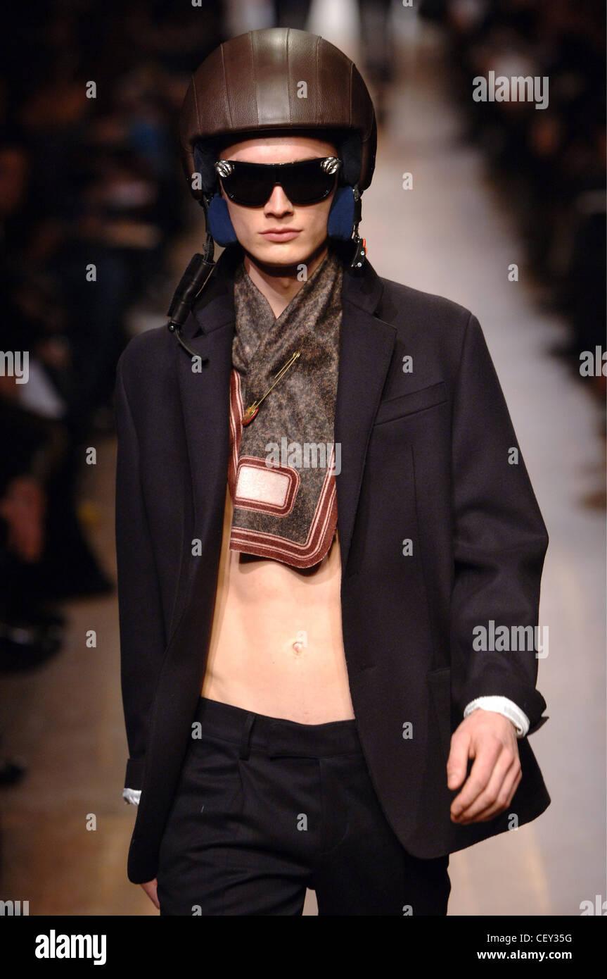 860c9d3e3ccc6 Prada Menswear Milan A W Shirtless male wearing an open black suit jacket