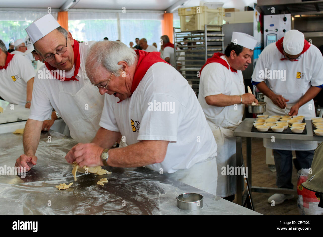 PARIS, FRANCE - MAY 16 - Fête du pain (Holiday of bread) near  Notre-Dame, unidentified bakers make pastries - Stock Image