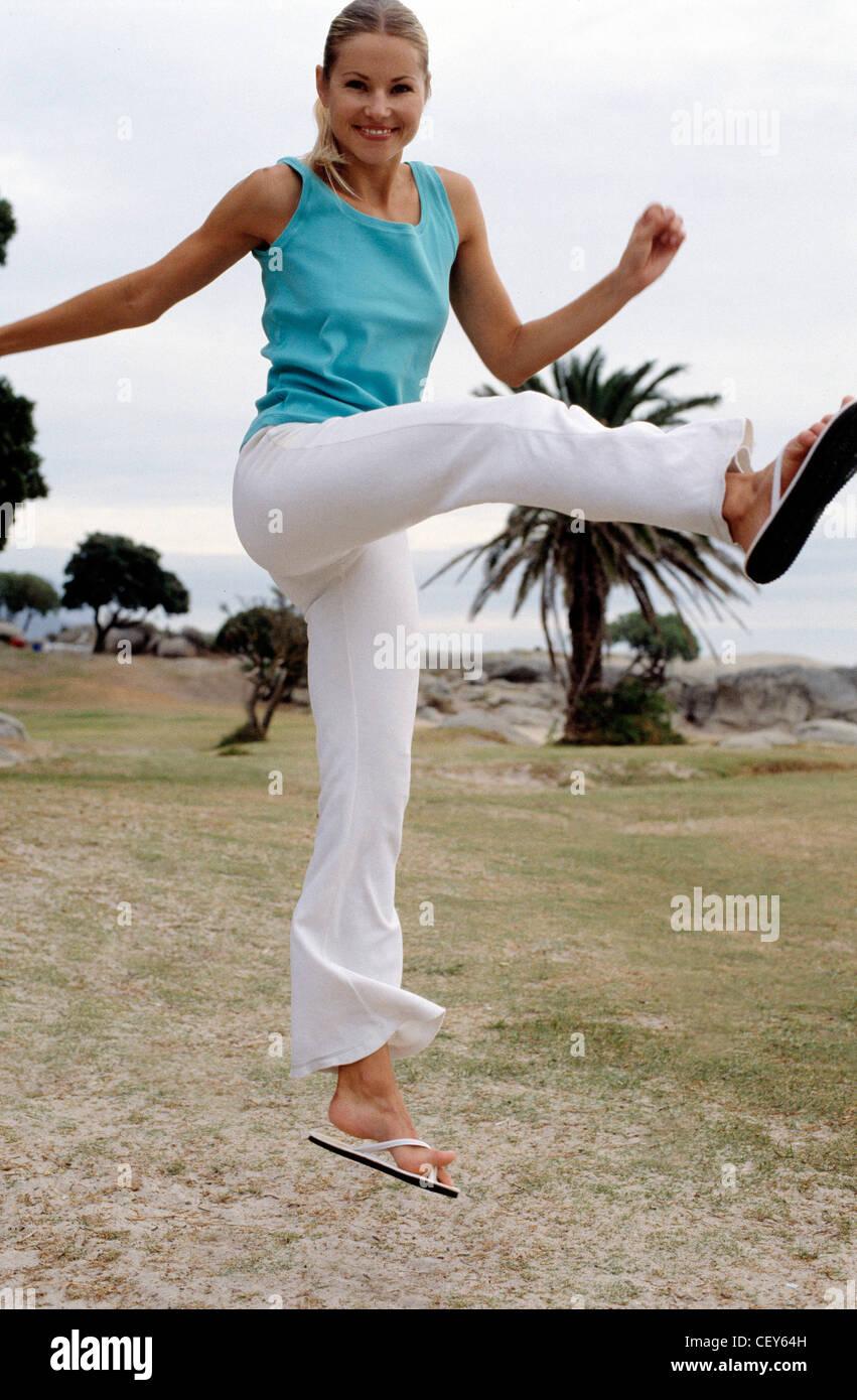 7419dce40ca636 Blonde female wearing sleeveless blue blouse