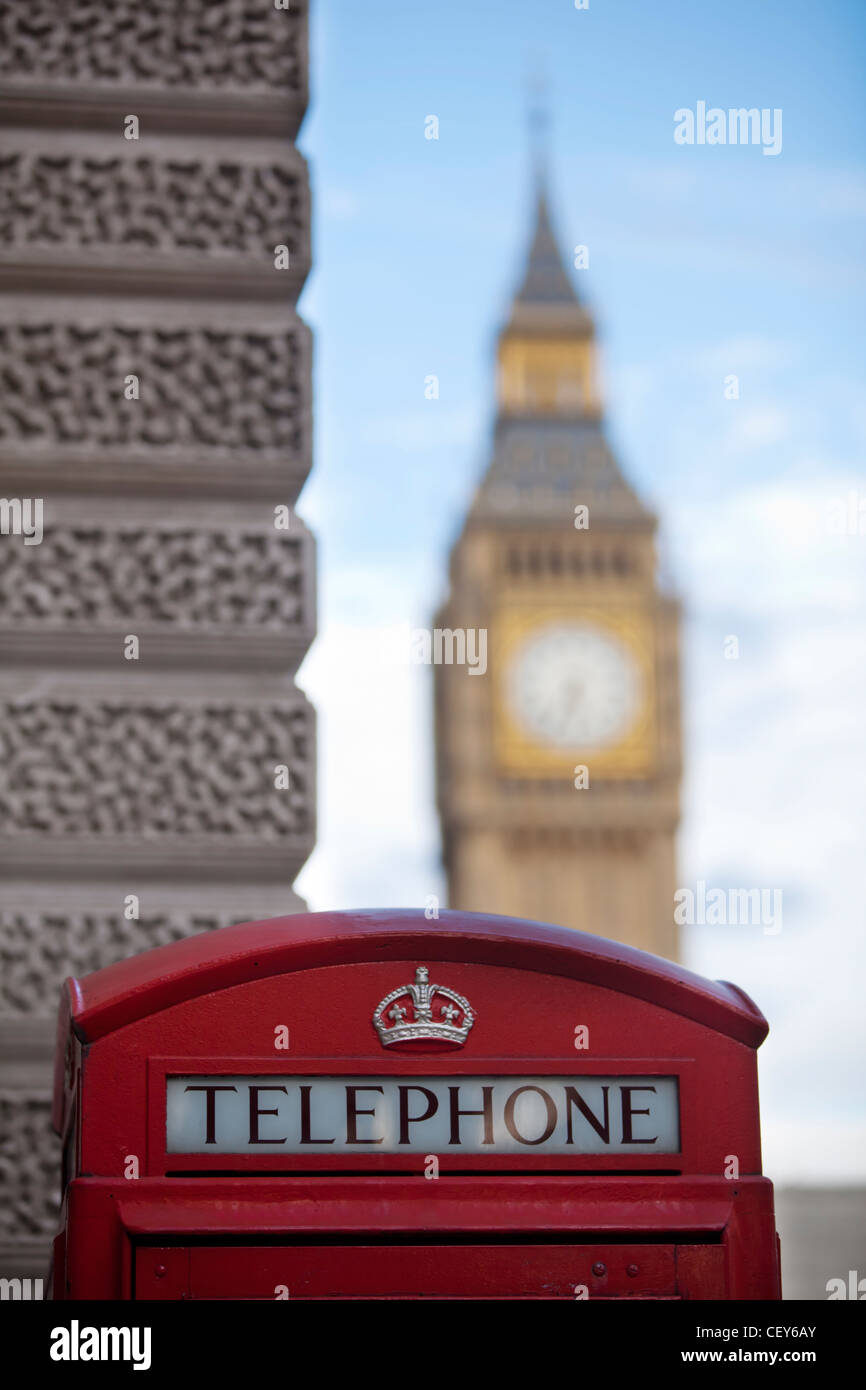 A view of a traditional red telephone box with Big Ben in the distance - Stock Image