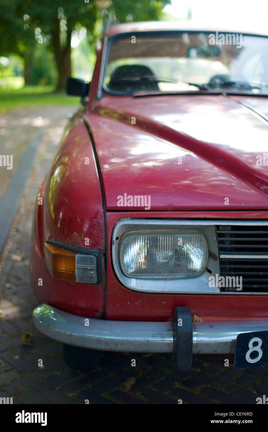 Front detail of an old and rusty red Saab 96V4 De Luxe. - Stock Image