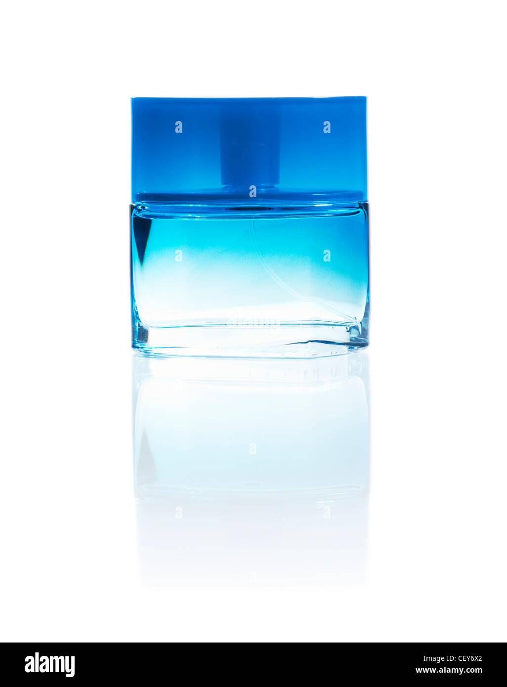 Blue perfume bottle with reflection isolated of white - Stock Image