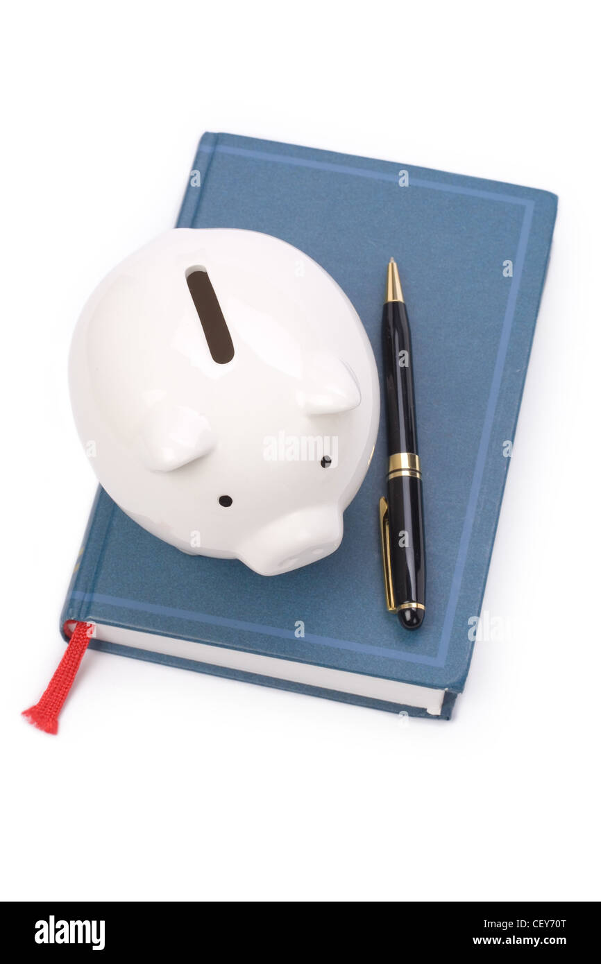 book and Piggy Bank, concept of education fund, tuition - Stock Image