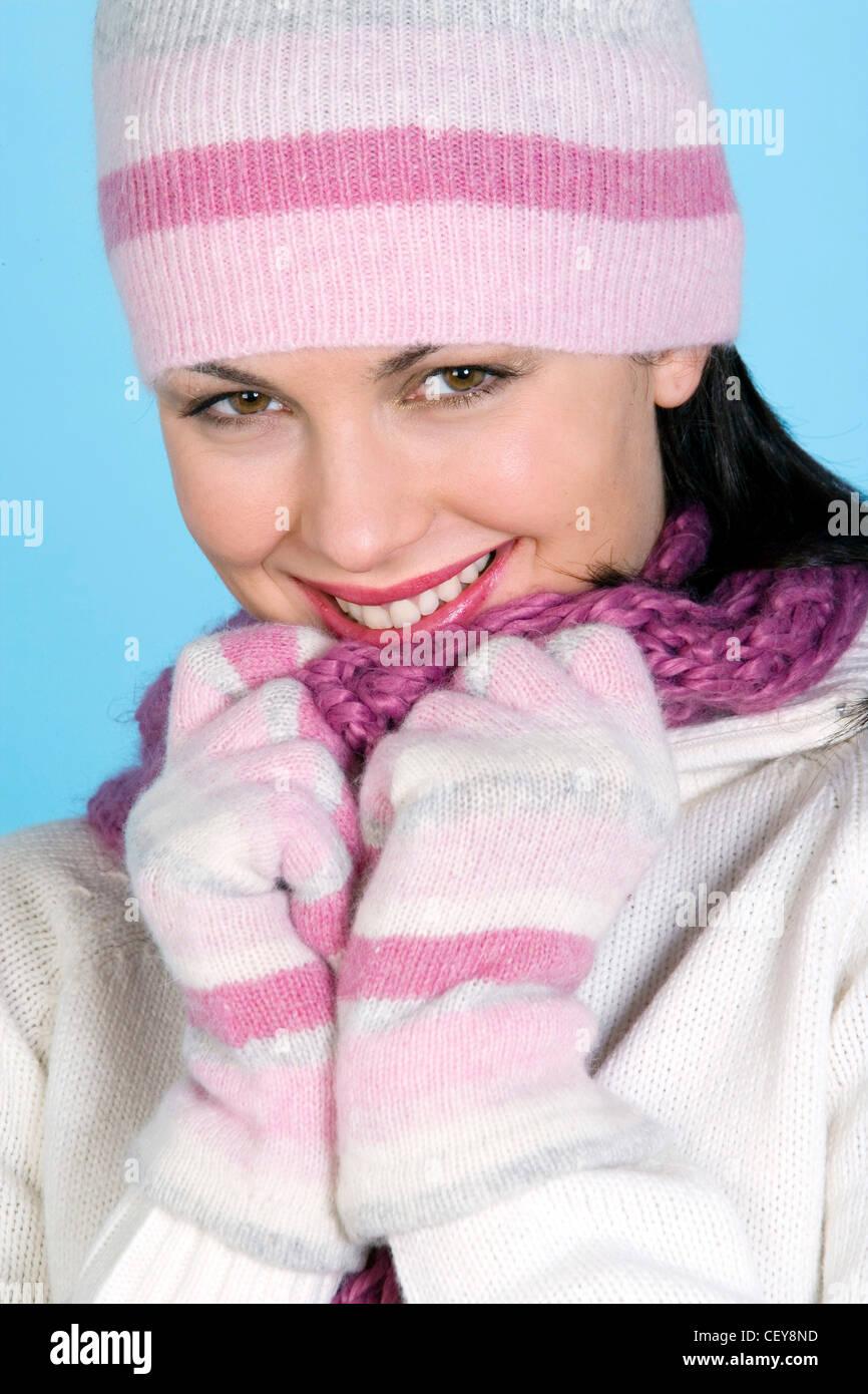 b7dcdcefef2 Brunette female wearing a pink stripey wool hat
