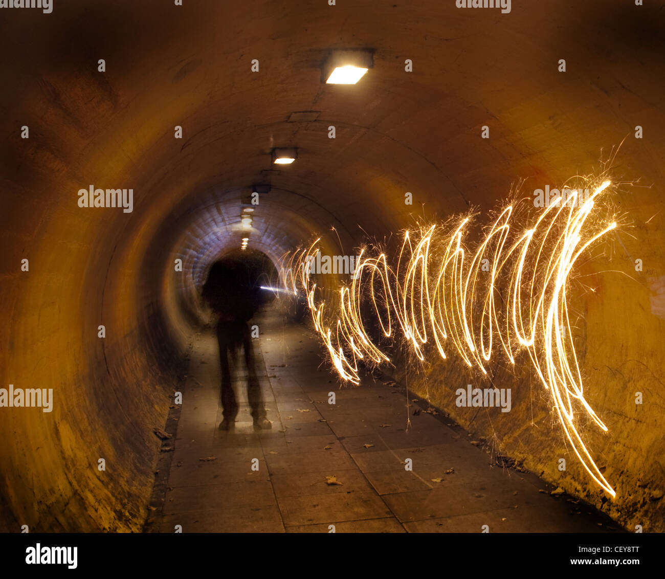 A man in a tunnel at night tunnelvision vision creating a path of light Stock Photo