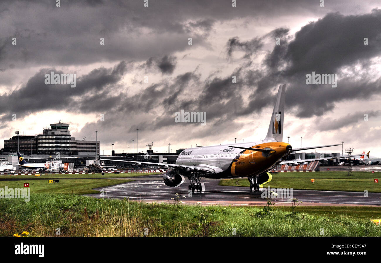 Monarch Aircraft taxi-ing into Manchester terminal 2 , Lancashire, UK - Stock Image