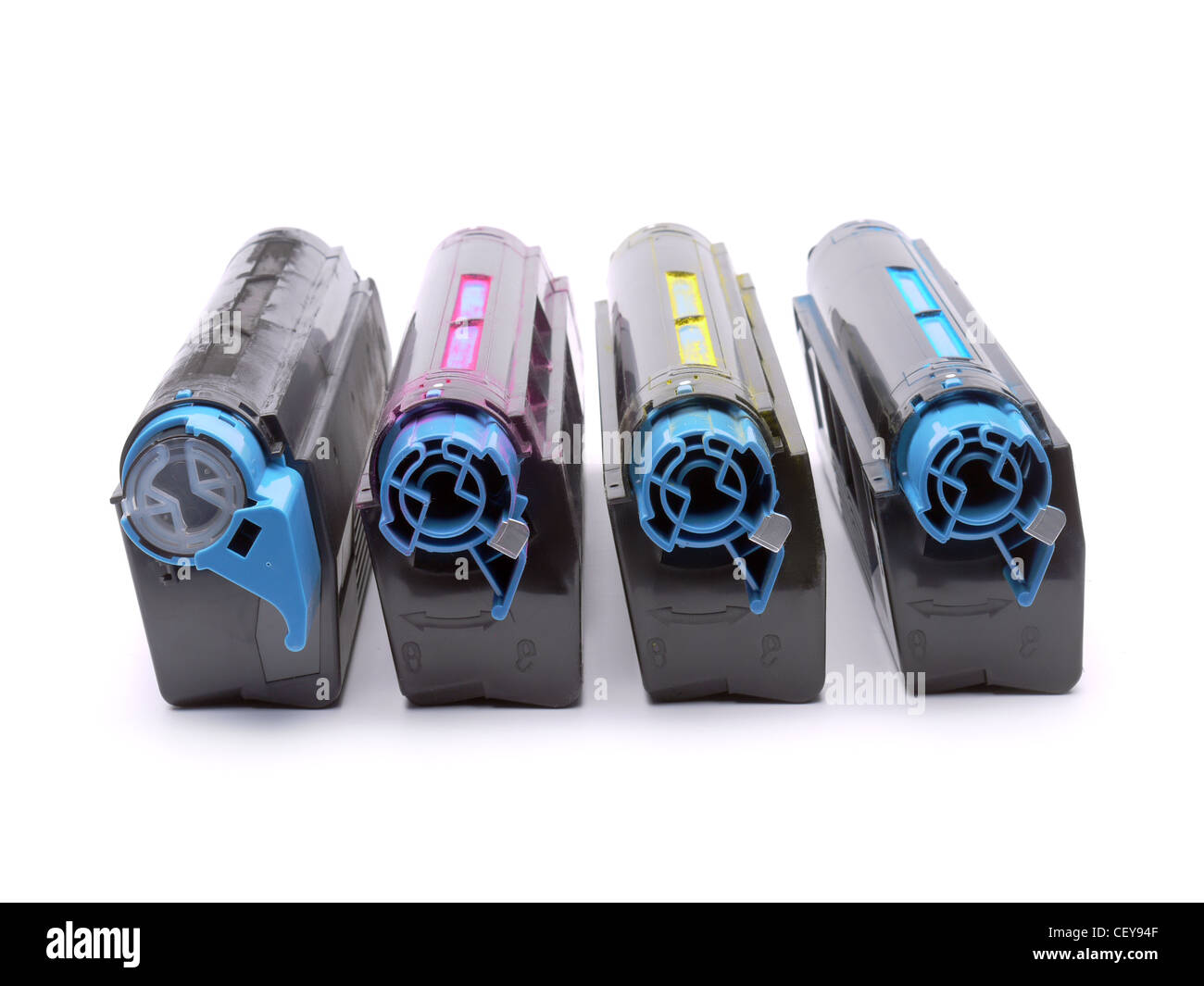 Four used laser printer toner cartridges of Cyan, Magenta, Yellow and black color shot over white background - Stock Image