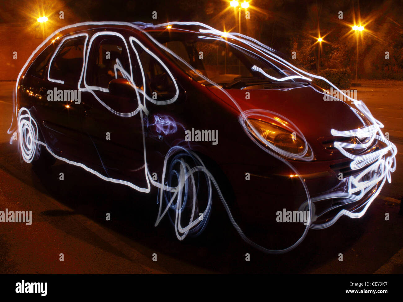 Example of long exposure painting with light. LED torch with a camera mounted on a tripod. Citroen Picasso. - Stock Image